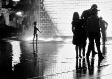 child-playing-in-water-fountain-michele-stoehr