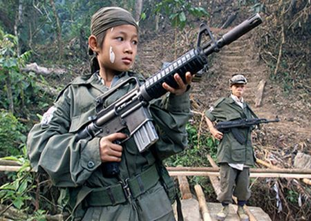 A YOUNG KAREN SOLDIER IS PICTURED IN A FILE PHOTO BRANDISHING HIS RIFLE IN MYANMAR