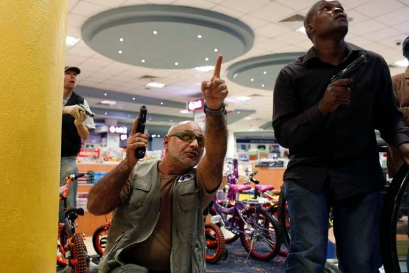 Security officers secure an area inside the Westgate Shopping Centre. (Photo by Siegfried Modola/Reuters)