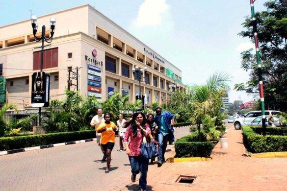 People run from the Westgate Mall. (Photo by Jason Straziuso/Associated Press)