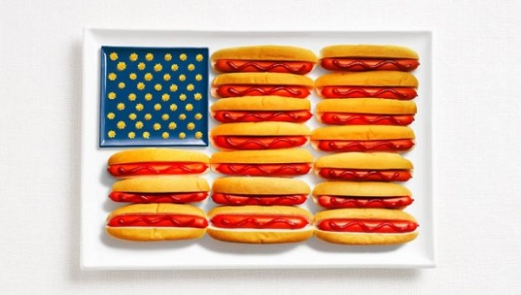 United States of America's flag made from hot dogs, ketchup, and mustard or cheese.