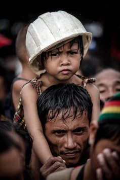 Typhoon victims wait to be evacuated at the airport in Tacloban, on the eastern island of Leyte on November 12, 2013 after Super Typhoon Haiyan swept over the Philippines. (Photo by Philippe Lopez/AFP Photo)