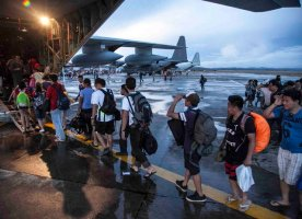 In this Tuesday, November 12, 2013, photo provided by the Navy Media Content Service (NMCS), civilians displaced by Typhoon Haiyan board a U.S. Marine Corps KC-130J Super Hercules at Tacloban Air Base before being transported to Manila, Philippines. U.S. service members are assisting the Armed Forces of the Philippines joined the recovery efforts for the people affected in the aftermath of Typhoon Haiyan. (Photo by Lance Cpl. Anne K. Henry/AP Photo/NMCS/Released)