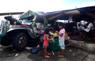 Children play beside a damaged jeepney converted into a living quarter in an area devastated by Typhoon Haiyan on November 11, 2013 in Leyte, Philippines. (Photo by Dondi Tawatao/Getty Images)