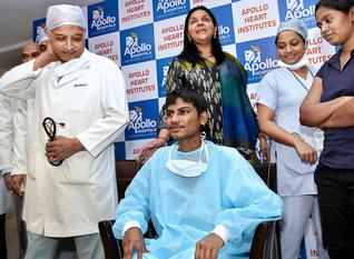 Chief cardiothoracic surgeon Vijay Dikshit (left) along with patient Veer Anjaneyulu addressing a press conference in Hyderabad on Monday. Apollo Hospital MD Sangeeta Reddy is also present.—PHOTO: NAGARA GOPAL