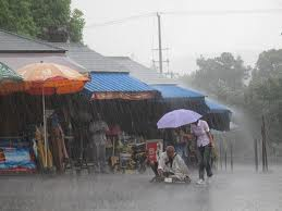 She is drenched, but helping him. Salute her