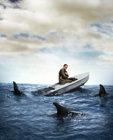 Sharks surrounding man sitting in sinking boat