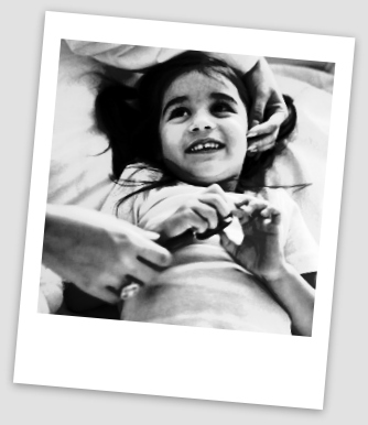 A small girl being examined by the doctor.