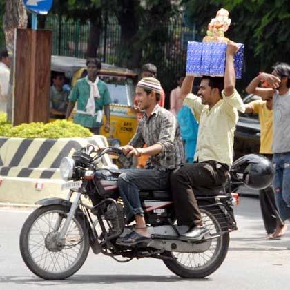Muslim Friend with his Hindu Friend Carrying Hindu God Ganesha