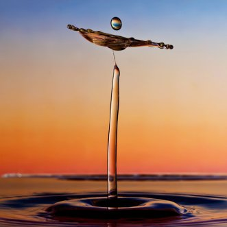 A tall splash at sunset